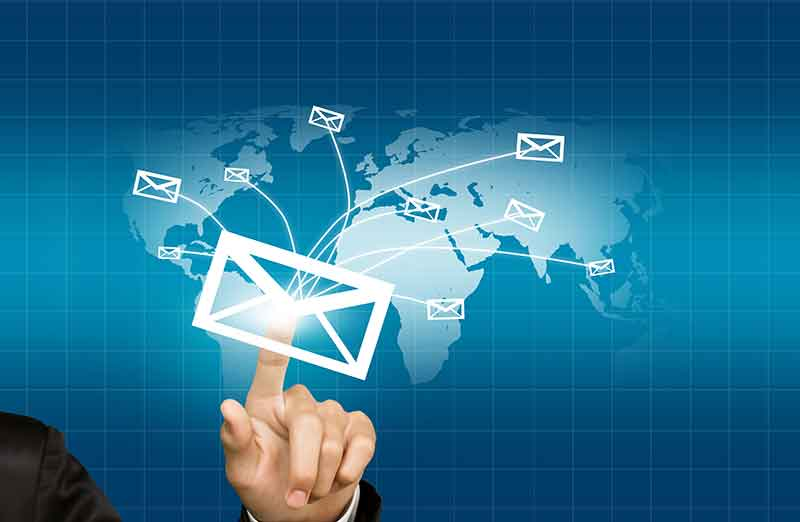 Hand holding an envelop and sending it globally